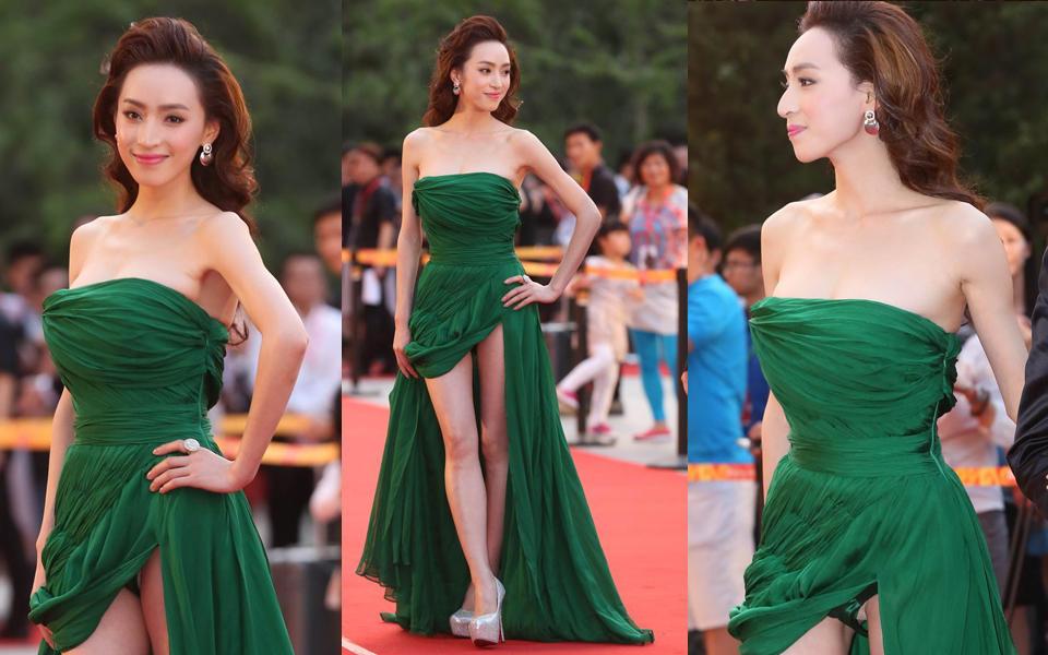 女星高衩裙开到胯骨秀性感