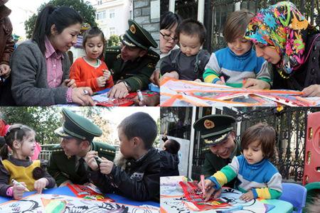 """义乌""""联合国""""幼儿园百对母子diy消防风筝放飞平安"""